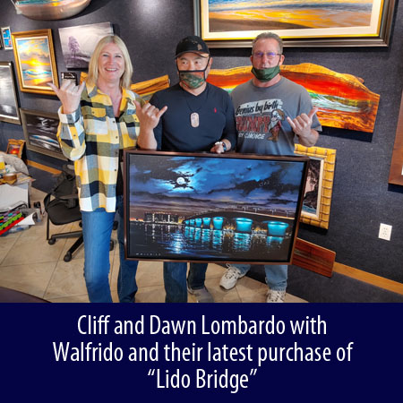 Cliff and Dawn Lombardo with Walfrido and their latest purchase of Lido Bridge at Wyland Gallery Sarasota