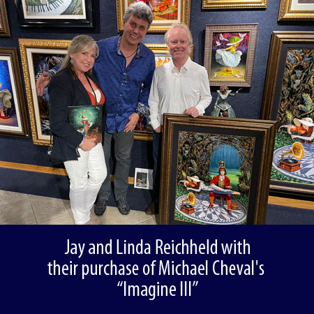 Jay and Linda Reichheld with their purchase of Michael Cheval's Imagine III at Wyland Gallery Sarasota